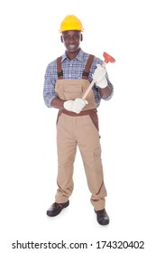 Young Handyman Holding Plunger Over White Background
