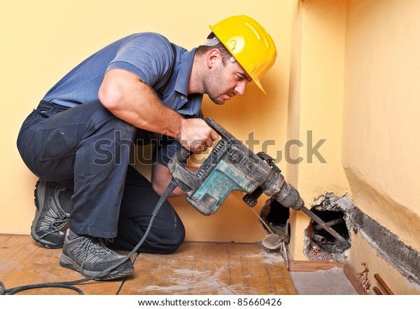young handyman on duty with electric drill
