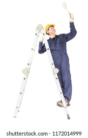 Young handyman in uniform standing on ladder while using paint roller, Cutout isolated on white background with clipping path