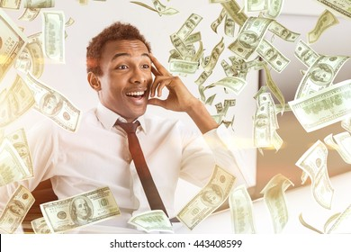 Young happy african american businessman with abstract dollar bill rain
