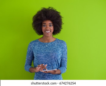 Young Happy African American Woman Using Digital Tablet  Isolated on a green background