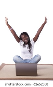 young happy african woman on the carpet surfing the internet (isolated on white)