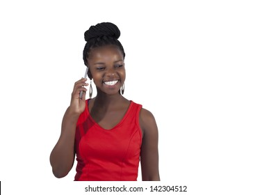 Young happy african woman talking into her cell phone on white background