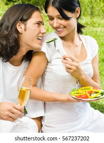 Young happy amorous couple on picnic, outdoors. Love, flirt, romantic, relations theme concept.