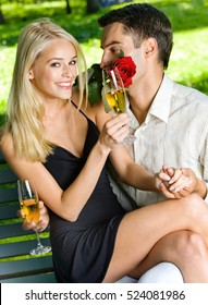 Young happy amorous couple together, outdoors. Love, flirt, romantic, relations, celebration theme concept.