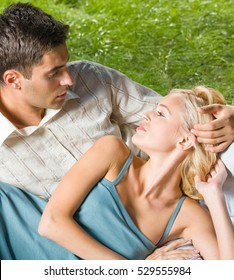 Young happy amorous couple together, outdoors. Love, flirt, romantic, relations theme concept.