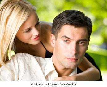 Young happy amorous embracing couple, outdoors. Love, flirt, romantic, relations theme concept.