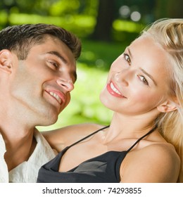 Young happy amorous embracing couple, outdoors