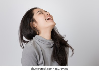 Young happy Asia woman is laughing.