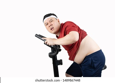 Young happy Asian fat man with big belly in red sportswear exercising with sport equipment, isolated on white background with copy space. Body shape, weight loss, sport and healthy concept.