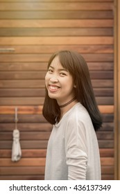 Young happy Asian woman with smiley face.