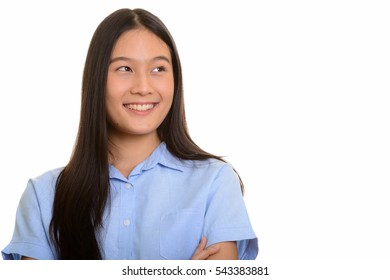 Young happy Asian woman smiling and thinking