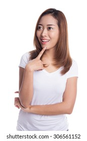Young happy asian woman thinking, looking to copy space, isolated on white background