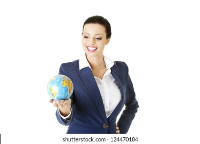 Young happy attractive brunette businesswoman holding the globe , isolated on white