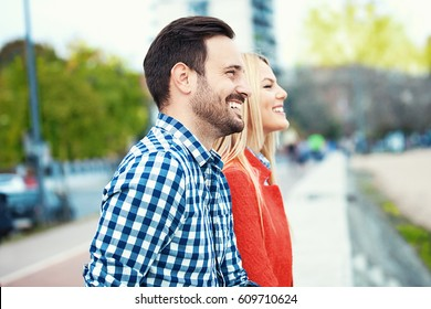 Young happy and attractive couple is enjoying outside.