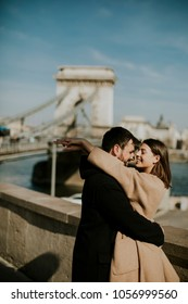 Young happy attractive couple in love hugging at the background of the magnificent landscape view of Budapest, Hungary