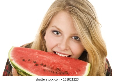 Young happy attractive girl posing in studio . Long-haired beautiful blonde with watermelon .