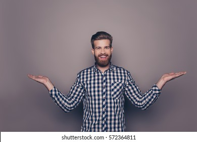 Young happy bearded man gesturing with hands and showing balance.