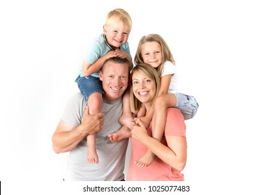 young happy and beautiful American family with husband and wife carrying on their back little son and lovely young daughter in love parents and children concept isolated on white background