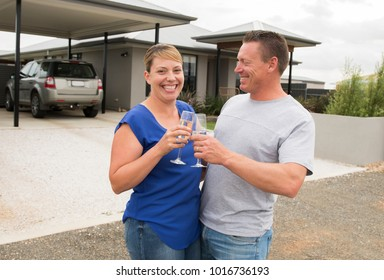 young happy and beautiful couple in love drinking champagne or wine having sweet toast celebrating anniversary or valentines day outdoors in lifestyle relationship husband and wife concept