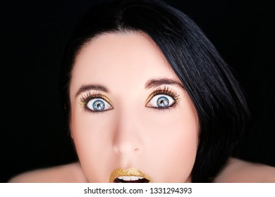 Young happy beautiful woman with bright makeup  on a black background