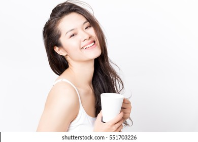 Young happy beauty healthy Asian woman holding white tea cup with smiley face.