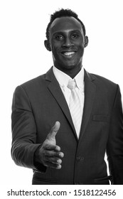 Young happy black African businessman smiling and giving handshake
