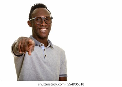 Young happy black African man smiling and pointing at camera