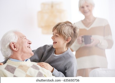Young happy boy laughing and having fun with grandfather