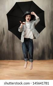 Young happy boy with umbrella
