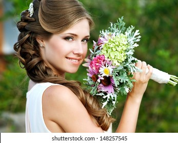 Young Happy Bride With Flower Bouquet