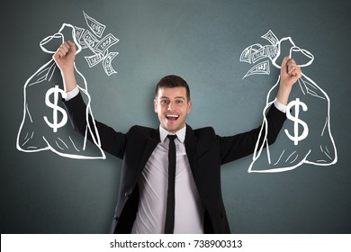 Young Happy Businessman Holding Drawn Money Bag Sketch Over Background