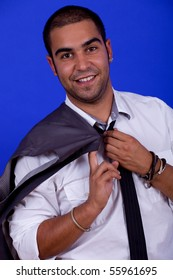 young happy businessman, on a blue background