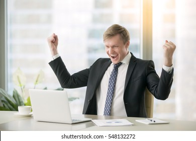 Young happy businessman with really impressive achievements, victory dance, fast growing company, rewarded, won a good contract, successful deal, positive news on stock, screaming with happiness
