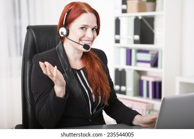Young happy businesswoman with headset