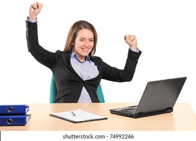 A young happy businesswoman in her office isolated on white background