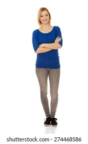 Young happy casual woman standing.