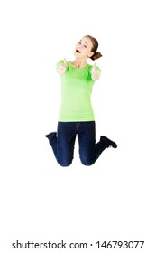 Young happy caucasian woman jumping in the air with thumbs up , isolated on white background