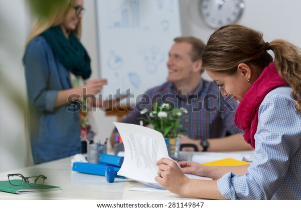 Young happy colleagues working at modern office
