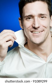Young happy confident man in white shirt