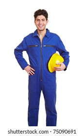 Young happy construction worker in a blue jumpsuit