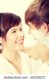 Young happy couple at bathroom