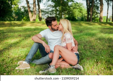 Young happy couple being in love and kissing