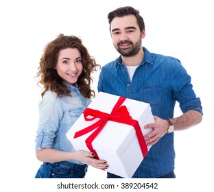 young happy couple with big gift box isolated on white background