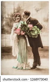 Young happy couple celebrated New year. Vintage picture with original film grain and blur