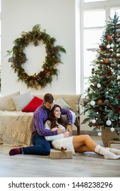 Young happy couple celebrating christmas at home. Christmas and holiday concept.