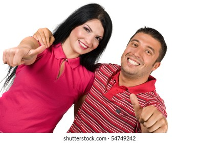 Young happy couple embrace giving thumbs-up and man holding his hand on woman shoulders and both smiling for camera ,left corner view isolated on white background