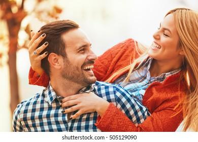 Young happy couple is enjoying outside.
