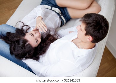 young happy couple,   girl lying on man's lap, lifestyle