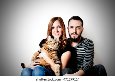 Young happy couple with her cat, pets.  Lifestyle